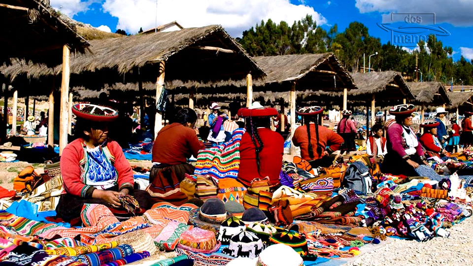 Women in traditional clothing selling Peruvian textiles at Chincheros