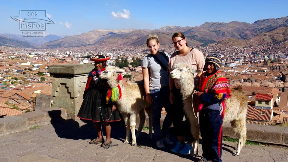 Members of the local communities with tourists in Cusco